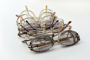 Old glasses in iron and horn-rimmed glasses