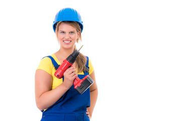 zufriedene handwerkerin mit bohrmaschiene