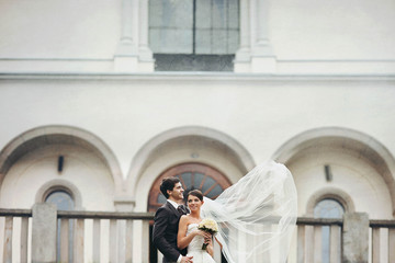 elegant stylish young couple beautiful bride and groom on the st