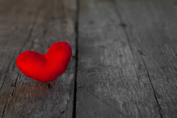 Valentines day red heart on old wooden background