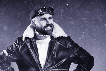 brutal portrait of a bearded man winter snow goggles
