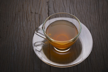 Hot tea cup on old wooden