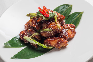 chicken fillet in tomato sauce with sesame seeds, chili