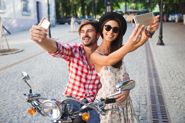 Young fashion couple taking selfie photo