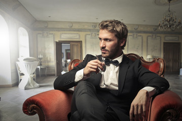 Handsome man drinking wine Wall mural