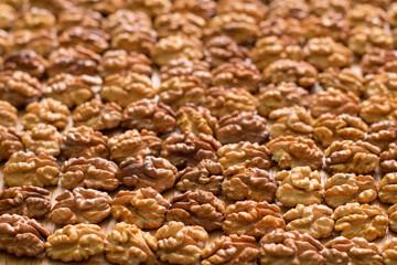 Background of symmetric walnut halves.