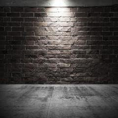 Concrete floor and brick wall with spot light illumination