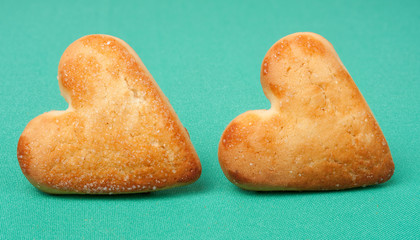 cookies in the shape of a heart on green background