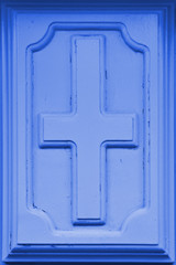 High resolution christian cross symbol in blue wooden background