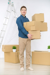 Pleasant man holding boxes