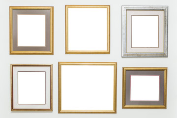 Picture frames on the white wall