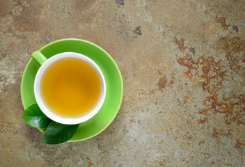 Cup of fresh green tea, overhead view, concept background