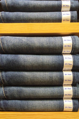 Mix Size of Classic Blue Jeans Texture with Paper Tag Exhibit on Wooden Shelf Showcase used as Template