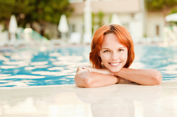 Smiling woman in bikini in pool