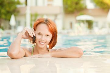 Smiling woman in bikini in pool