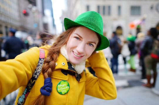 Young tourist taking a selfie during the annual St. Patrick's Day Parade in New York