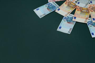 Euro banknotes on dark background