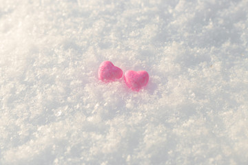 Little pink shiny hearts in the snow