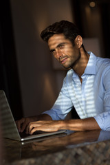 Goodlooking young man with laptop computer