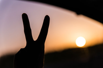 man showing the peace sign