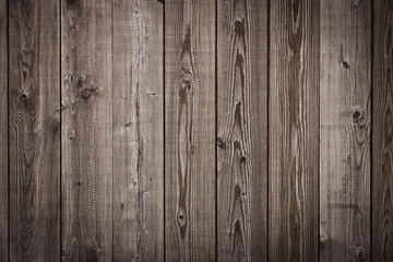 Old wooden dark brown boards, chocolate color fence, textured background