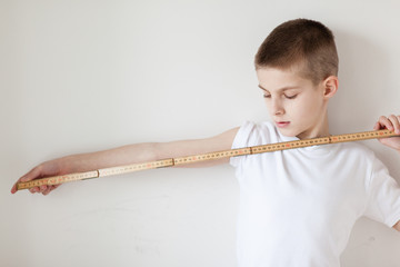 Handsome White Young Boy Holding a Meter Stick