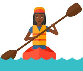 Woman riding in canoe.