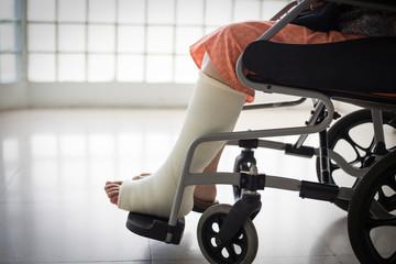 Senior adult leg injury sitting