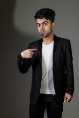 Studio shot of Iraq brunette boy wearing black suit