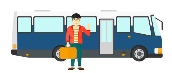 Man standing near bus.