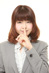 young Japanese businesswoman whith silence gestures