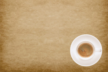 Coffee cup on old paper texture background with space to adding text