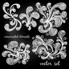 Set of ornamental elements. Curls. Template for design. White chalk on a blackboard