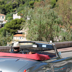 Man driving elegant retro convertible