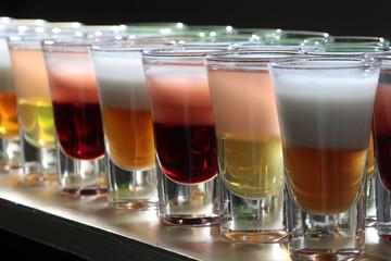 Closeup of many alcoholic shots