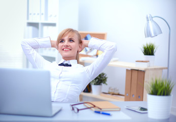 Business woman relaxing with  hands behind her head and sitting on a chair