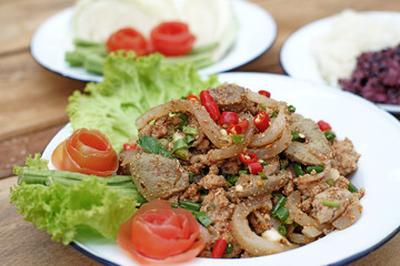 sliced grilled pork spicy salad with sticky rice and vegetable