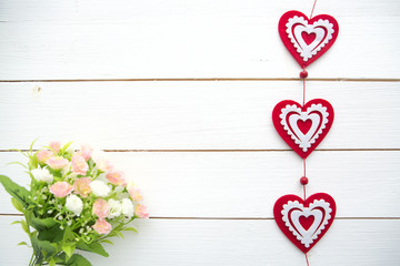 Spring Blossom and heart over wooden background