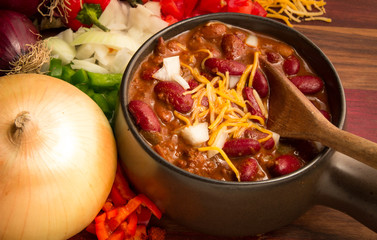 Spicy Bowl Of Chili. Hot bowl of fresh chili with cheese, onions, and peppers.