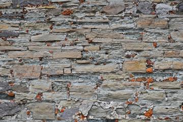 Old stone layered wall