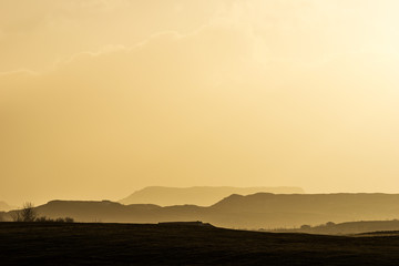 Mountain landscape bathing in golden late afternoon light in southern Iceland