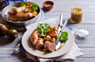 Grilled sausages with potatoes