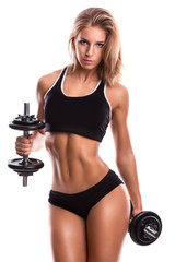 Sexy fitness girl with dumbbells