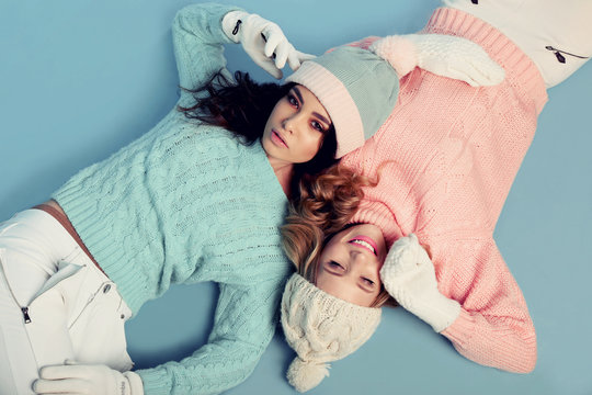 beautiful young girls wear cozy warm knitted clothes
