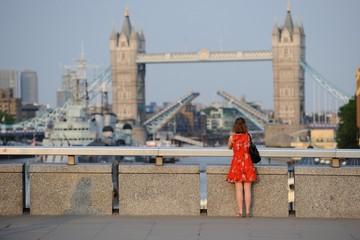 LONDON 2013 - A tourist from London by admiring the tower bridge in the background.