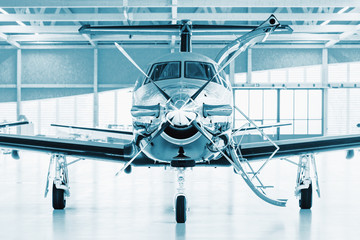 Single turboprop aircraft in hangar.  Wall mural