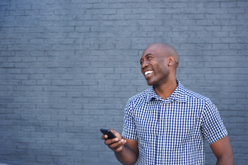 Smiling african american man with a mobile
