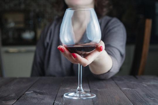 Female take wine glass