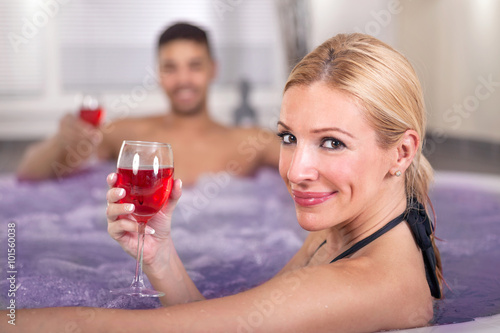 """""""Romantic couple drinking red wine in hot tub"""" Stock photo ..."""