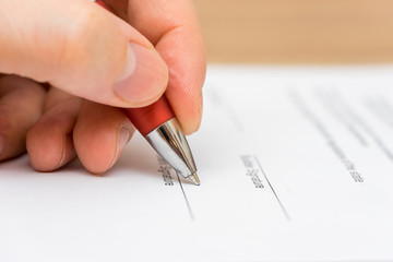 Closeup of businessman  signing contract